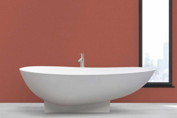 Copenhagen badekar fra Interform er et lekkert frittstående designbadekar i hvit matt kompositt / Solid surface. Baderommets smykke. Klikkventil i samme utførelse som badekaret. Gulvarmatur. Terracotta veggfarge