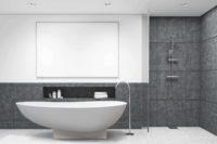 Copenhagen badekar fra Interform er et lekkert frittstående designbadekar i hvit matt kompositt / Solid surface. Baderommets smykke. Klikkventil i samme utførelse som badekaret. Gulvarmatur. Grå flis. Dusj