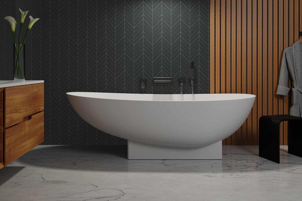 Copebhagen design badekar fra Interform. Spilevegg og fiskeben flis. Marmorgulv og tredetaljer.