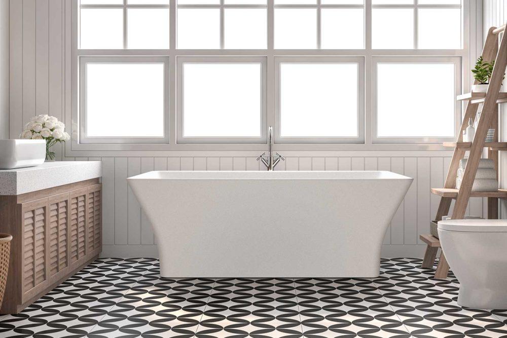 Cube frittstående badekar i kompositt / solid surface fra Interform. Hvit matt silkemyk overflate. Trepanel på vegg og svarte og hvite fliser på gulv.