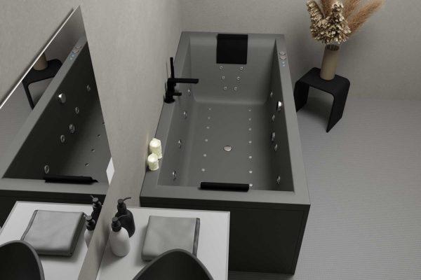 Nemo 180 badekar i grå matt akryl. Svart matt krakk med pampas i vase. Svart matt armatur, nakkeputer og servant. Grå tak og vegg.