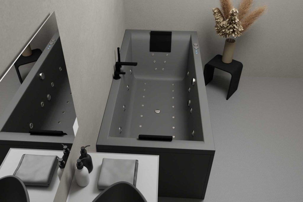 Nemo 180 grå matt med Vega svart armatur og nakkeputer i svart matt. Grå gulv og vegg med svart servant på grå baderomsmøbel. Sort krakk med beige vase og pampas. Massasje / boblebad