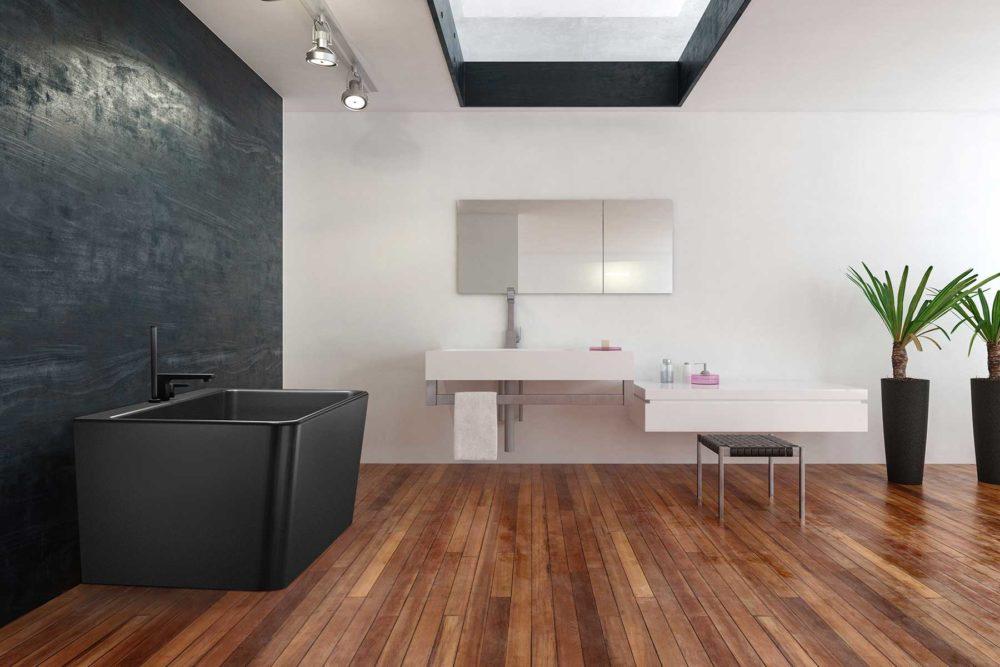 Saga Svart Back To Wall er et stilrent badekar i silkemyk, matt kompositt. Den ergonomiske utformingen gjør det svært behagelig å sitte i. God plass for å montere armatur på badekaret. Leveres med klikkventil og justerbare ben. flott tregulv og vegg i svart og hvit microsement. Flott innredning i hvit betonglook.