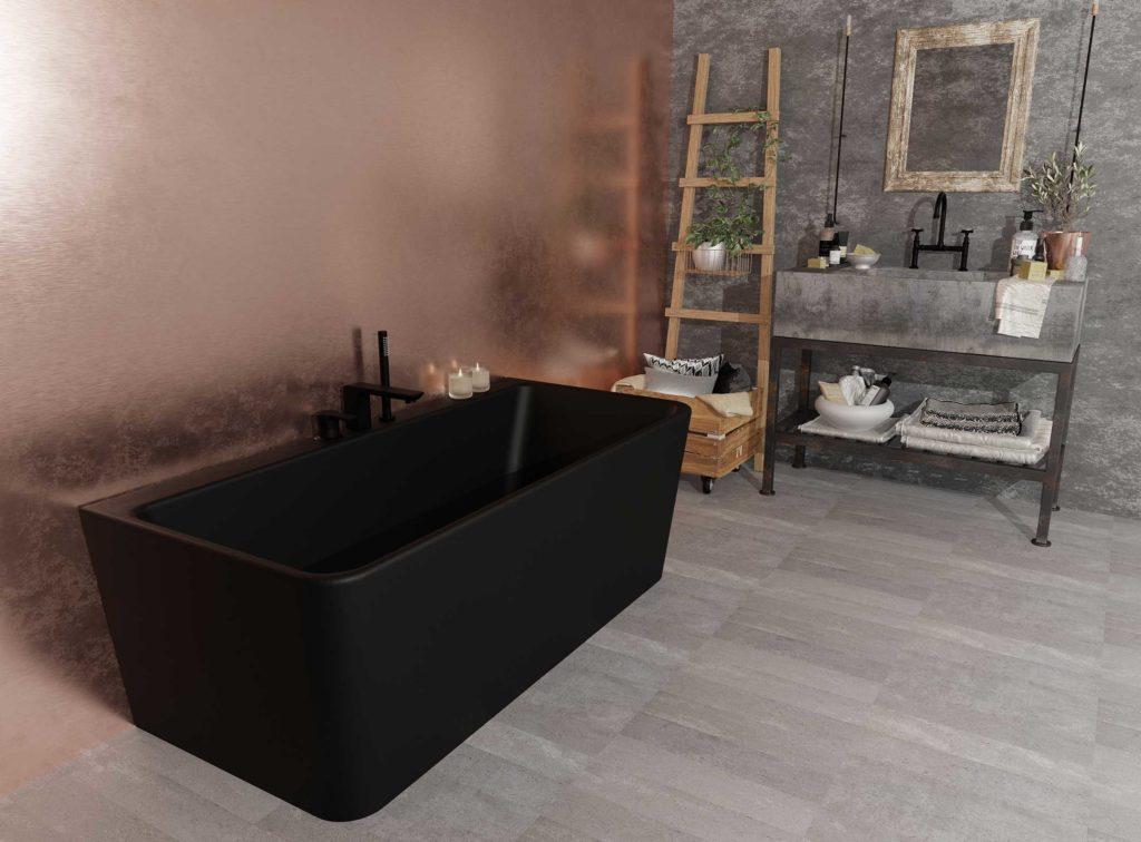 """Saga """"back to wall"""" badekar i svart matt. Vegg i kobber og betong. Betongvask med svart armatur."""