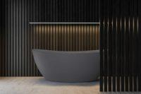 """Viena komposittkar fra Interform i grå matt """"betong look"""". spraglete grå betong gulv. Spiler på vegg og i front av badekar. Stor ledbjelke som lyser opp badekaret"""
