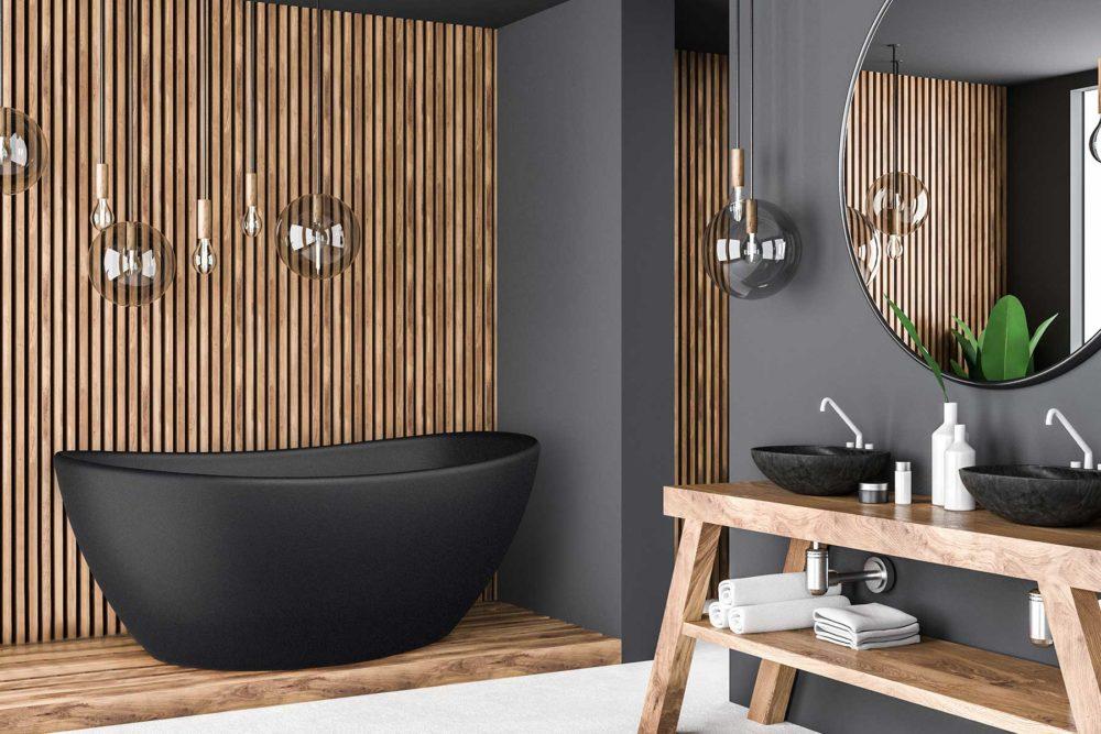 Viena svart badekar fra Interform i svart matt kompositt / solid surface. Spiler / Spilevegg og grå vegg. Hvit armatur og rundt speil.