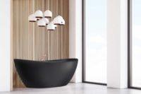 Viena Svart er et lekkert frittstående badekar. Svart vegg armatur. Det ovale designet skaper et mykt og moderne uttrykk. Utførelsen i svart matt kompositt gjør dette til et blikkfang. messing armatur og flott spilevegg. Spiler og utsikt