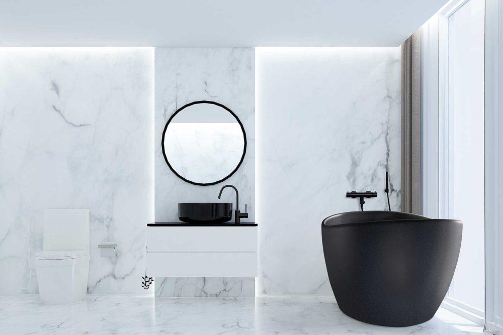 Viena Svart er et lekkert frittstående badekar. Svart vegg armatur. Det ovale designet skaper et mykt og moderne uttrykk. Utførelsen i svart matt kompositt gjør dette til et blikkfang. Marmor gulv og vegg. utsikt fra badekar. Svart servant og speil