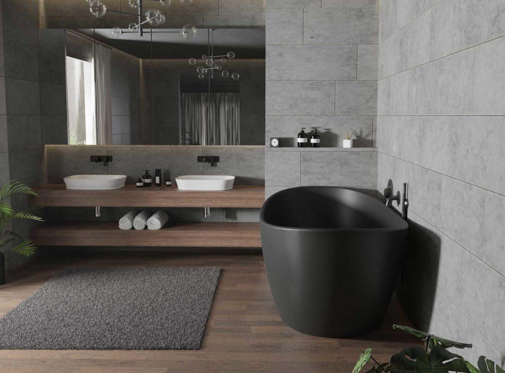 Viena frittstående badekar i svart matt med svart matt veggarmatur. Dobbel servant og stort speil. Gulvflis i treimitasjon og store flis på vegg i betongimitasjon